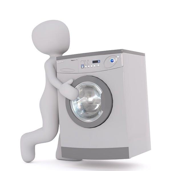 洗濯機を運ぶ人